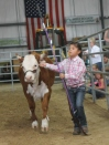 Jayleen showing Honey Bee. Honey Bee is a fall heifer from BB Cattle co.